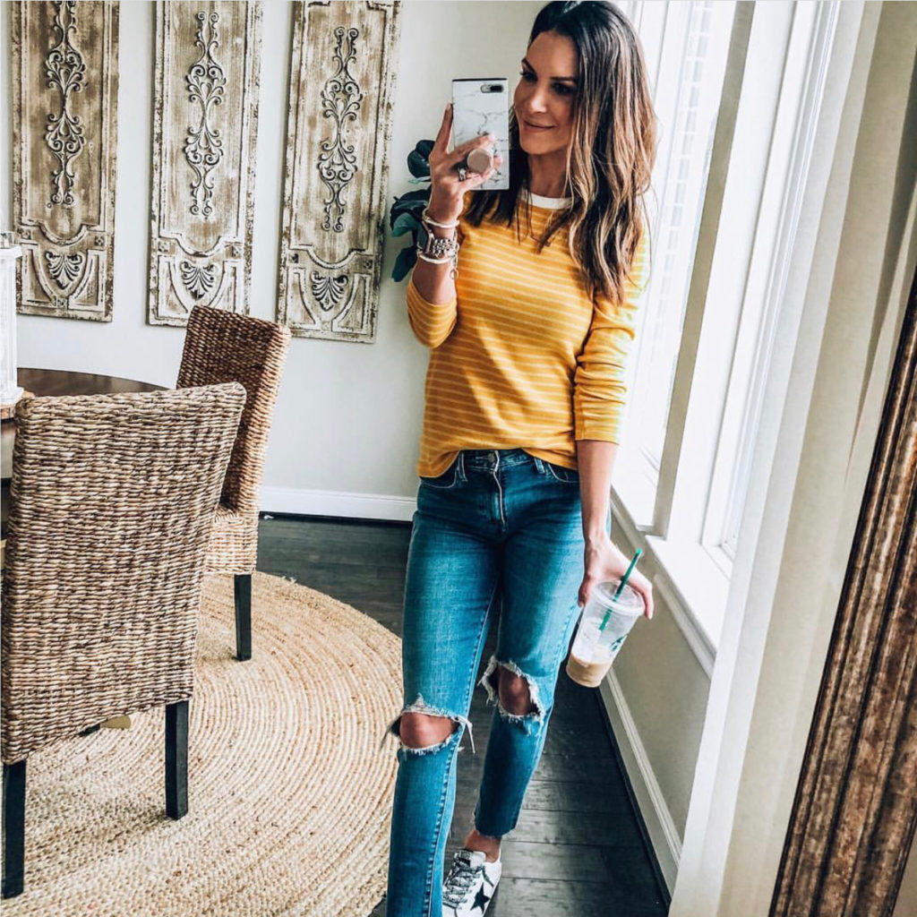 fitted yellow striped shirt and distressed denim