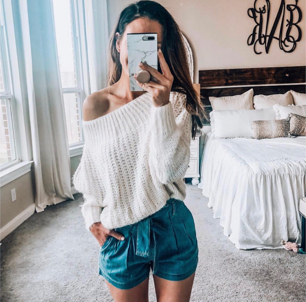 off the shoulder sweater and paperbag waist shorts. High waisted shorts.